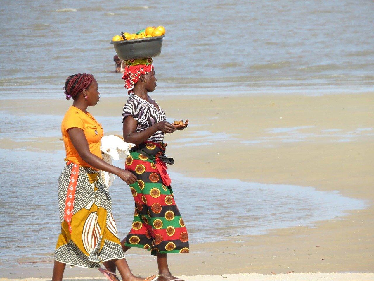 women on beach in Mozambique